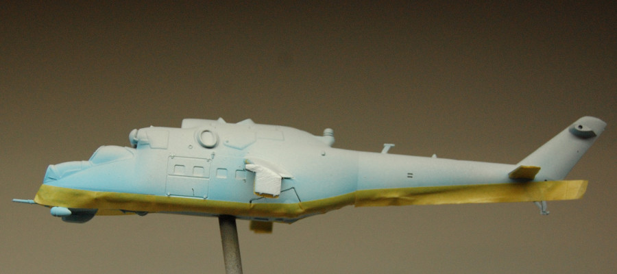 The sky blue masked off for the next layer of paint.
